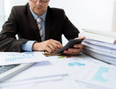 Accountant working on stack of papers